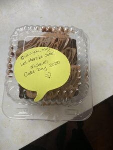 Chocolate in a box with a note saying screw you ms! Let there be cake!